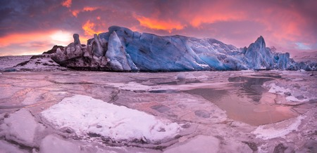 Famous Fjallsarlon glacier and lagoon with icebergs swimming on frozen water, southern Iceland, Europe.