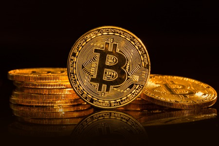 Bitcoin gold coin on black background. Virtual cryptocurrency concept. Stock Photo