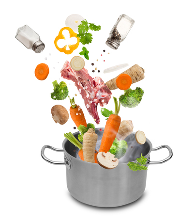 Stainless steel pot with flying ingredients, isolated on white background Stock Photo