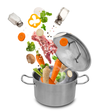 Stainless steel pot with flying ingredients, isolated on white background 写真素材