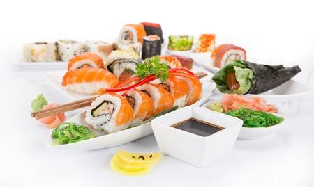 Japanese Sushi over white background, close-up.