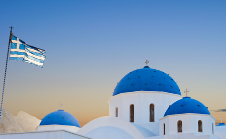 Classic view of blue dome church in Santorini. Perissa Village, Greece.