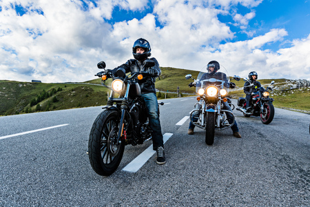 Motorcycle drivers riding in Alpine highway, Nockalmstrasse, Austria, Europe. Stock Photo