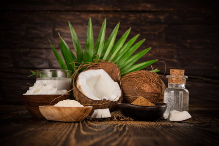 close up of a coconut oil on old wooden background Banco de Imagens