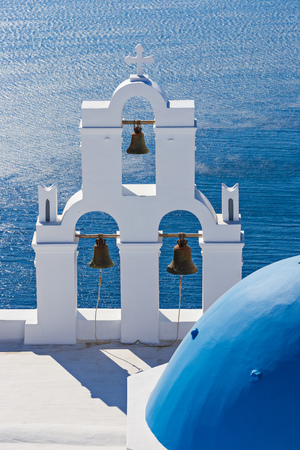 The Three bells of Fira and blue dome, Santorini, Greece, Europe. Фото со стока