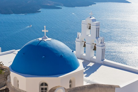 The Three bells of Fira and blue dome, Santorini, Greece, Europe. 스톡 콘텐츠
