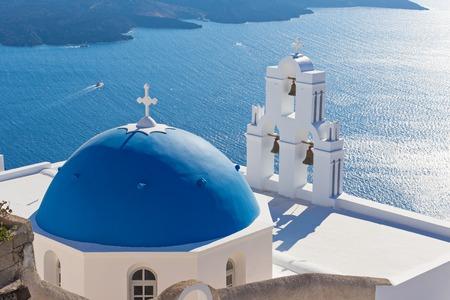 The Three bells of Fira and blue dome, Santorini, Greece, Europe. Foto de archivo