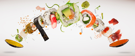 Pieces of delicious japanese sushi frozen in the air. Banco de Imagens