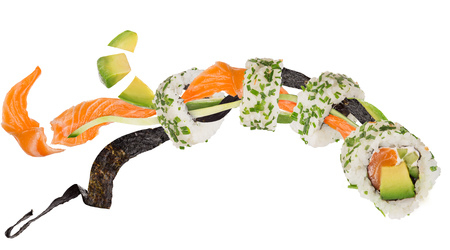 Pieces of delicious japanese sushi frozen in the air. Banco de Imagens