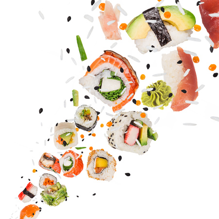 Pieces of delicious japanese sushi frozen in the air. Reklamní fotografie