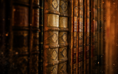 Antiquarian vintage books in old library.