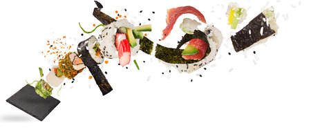 Pieces of delicious japanese sushi frozen in the air. 免版税图像