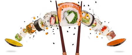 Pieces of delicious japanese sushi frozen in the air. Archivio Fotografico