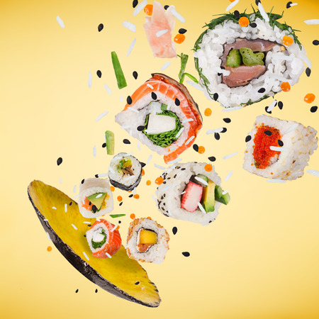 Pieces of delicious japanese sushi frozen in the air. 版權商用圖片