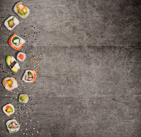 Traditional japanese sushi pieces on rustic concrete background. Stock Photo