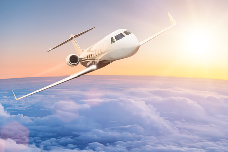 Commercial airplane flying above clouds. Stock Photo
