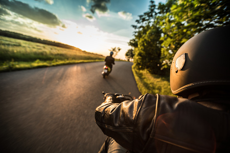 Man riding sportster motorcycle during sunset. Stock fotó