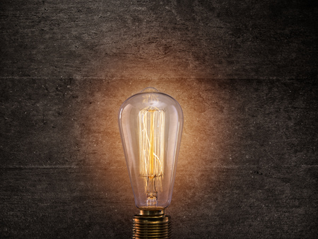 Vintage Edison light bulb on dark background. 스톡 콘텐츠