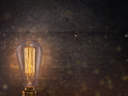 Vintage Edison light bulb on dark background. Banco de Imagens