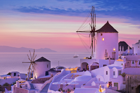 The famous sunset at Santorini in Oia village 写真素材