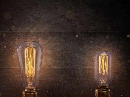 Vintage Edison light bulbs on dark background.