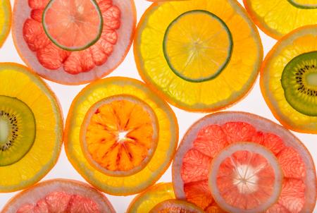 Bright fresh citrus slices, back light transparent fruit.