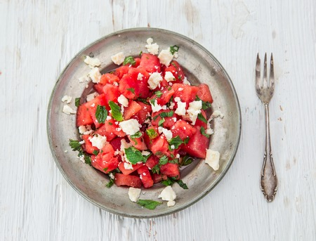 Fresh salad with water-melon, feta cheese, lime and mint. Stock Photo