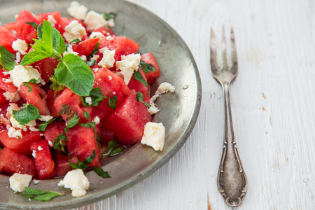 Fresh salad with water-melon, feta cheese, lime and mint. Foto de archivo