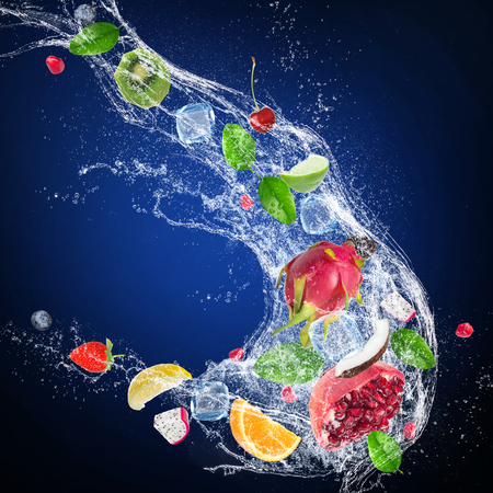 Citruses with water splash on dark background Stock Photo