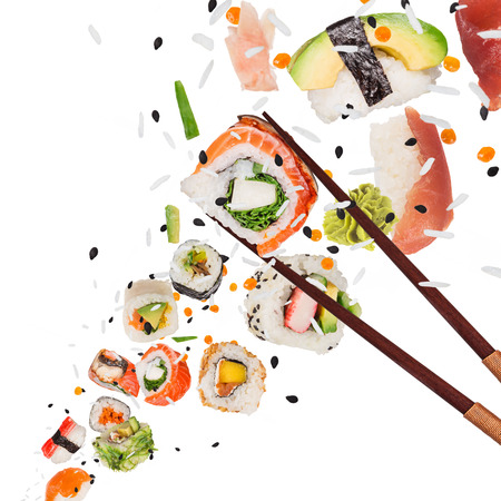 Pieces of delicious japanese sushi frozen in the air. Isolated on white background Imagens