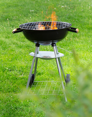 Garden grill with blistering briquettes, close-up. 스톡 콘텐츠