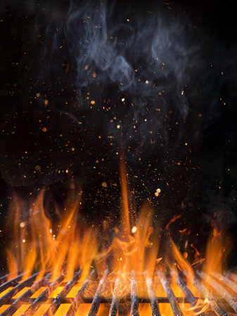 Empty flaming charcoal grill with open fire.
