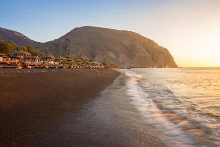 Perissa beach during sunrise on the Greek island of Santorini.