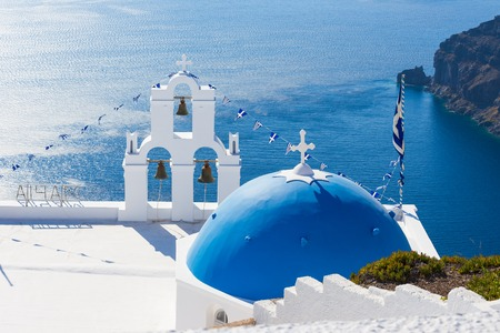 The Three bells of Fira and blue dome, Santorini, Greece.