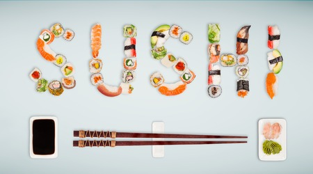 Traditional japanese sushi pieces making inscription. Foto de archivo