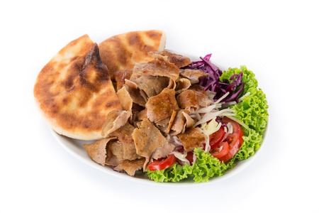 Turkish Doner Kebab plate with french fries isolated on white background.