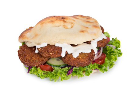 falafel with fresh vegetables in pita bread isolated on white background.