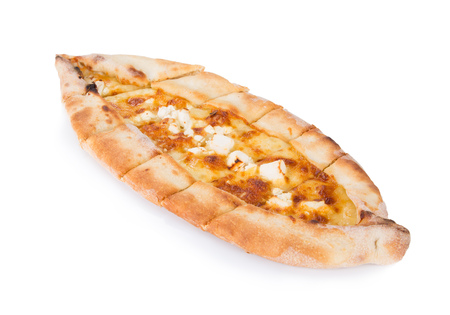 Traditional turkish pizza pide with cheese isolated on white. Top view.