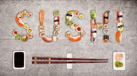 Traditional japanese sushi pieces making inscription. Standard-Bild - 102435914