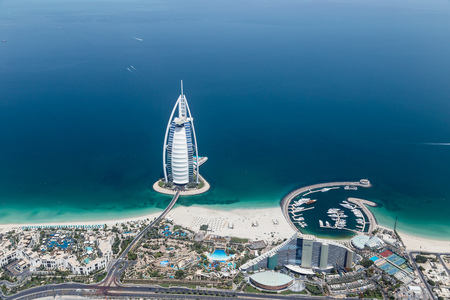 DUBAI, UAE - MAY 28: Burj Al Arab hotel on May 28, 2018 in Dubai, UAE. Burj Al Arab is a luxury unofficial 7star hotel built on an artificial island in front of Jumeirah beach. View from hydroplane. 報道画像
