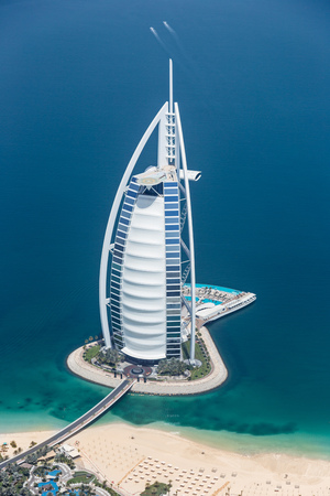 DUBAI, UAE - MAY 28: Burj Al Arab hotel on May 28, 2018 in Dubai, UAE. Burj Al Arab is a luxury unofficial 7star hotel built on an artificial island in front of Jumeirah beach. View from hydroplane. Editorial