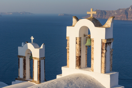 Beautiful yellow church dome on the edge of the town of Fira. Stock Photo