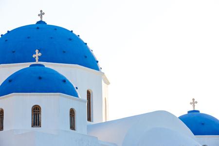 Classic view of blue dome church in Santorini. Stock Photo