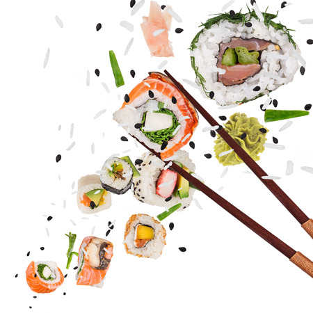 Pieces of delicious japanese sushi frozen in the air. Imagens