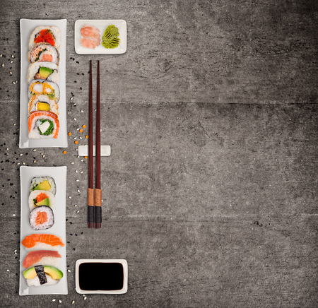 Traditional japanese sushi pieces on rustic concrete background. Foto de archivo