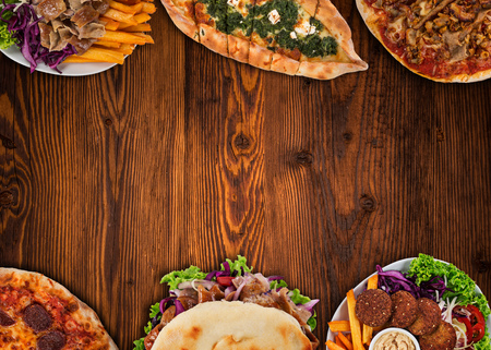 Top down view on traditional turkish meals on vintage wooden table. Close-up. Archivio Fotografico