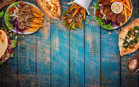 Top down view on traditional turkish meals on vintage wooden table. Close-up. Stockfoto
