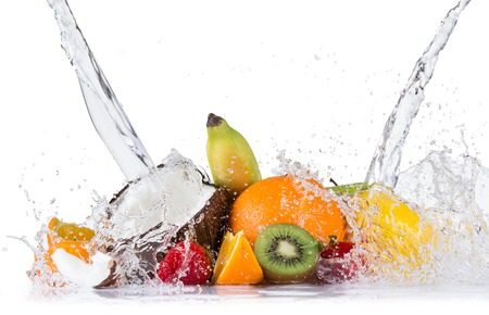 Fresh fruit with water splash over white background, close-up.