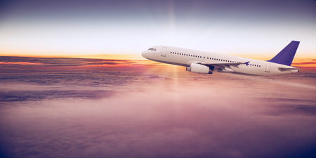 Commercial airplane flying above clouds. Reklamní fotografie