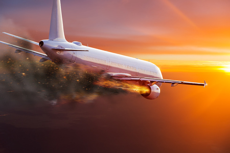 Airplane with engine on fire, concept of aerial disaster. Stock Photo